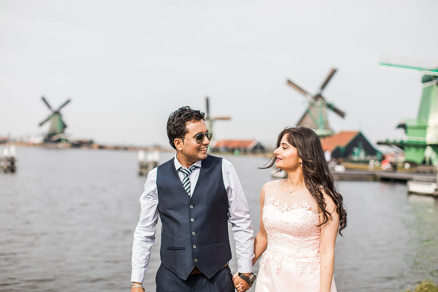 Prewedding photoshoot at Zaanse Schans windmill village near Amsterdam, Holland for an Indian couple