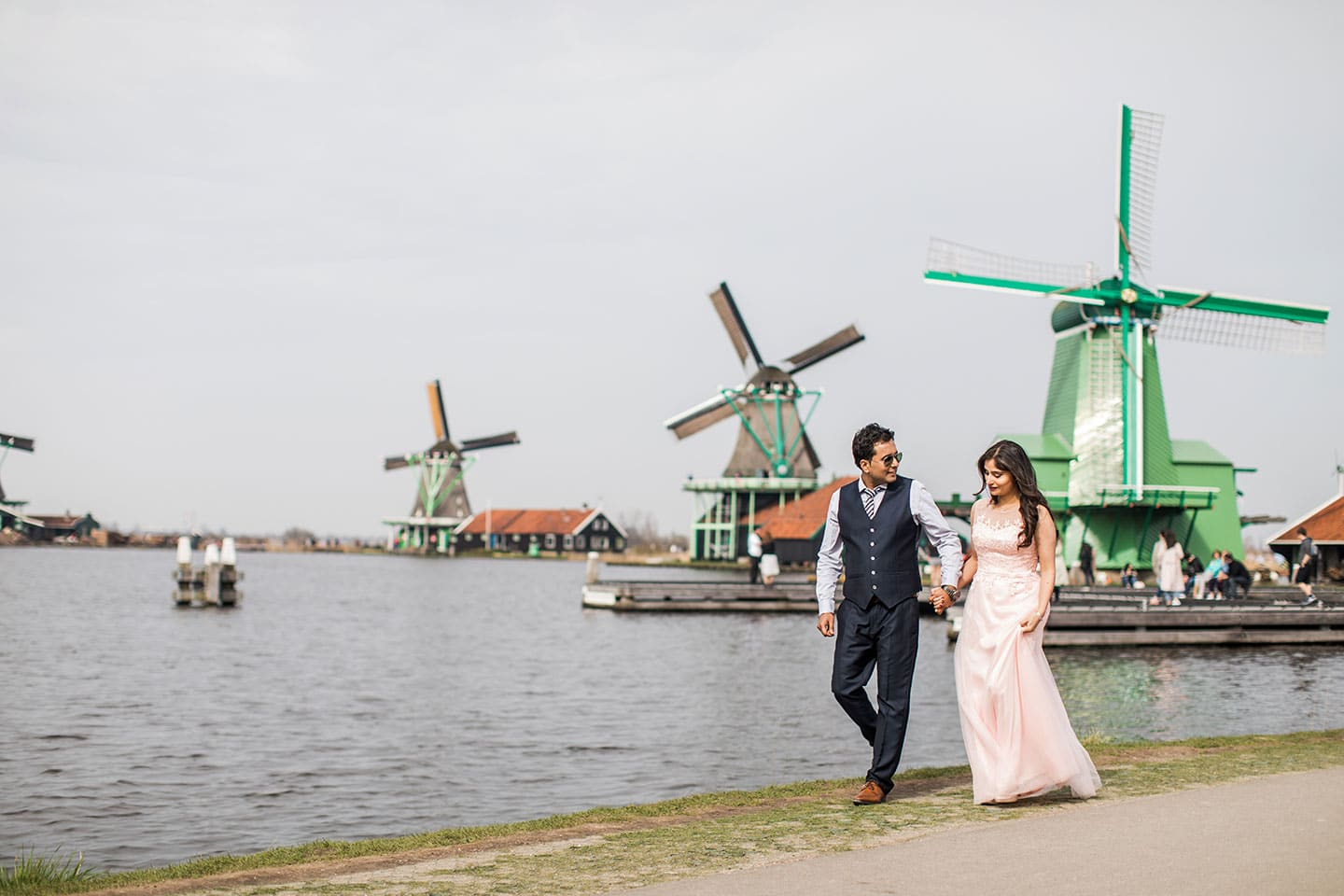 Prewedding photography Indian couple at Windmills of Zaanse Schans near Amsterdam, Holland
